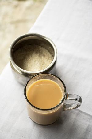 tarik: Milk tea and sugar storage on table Stock Photo