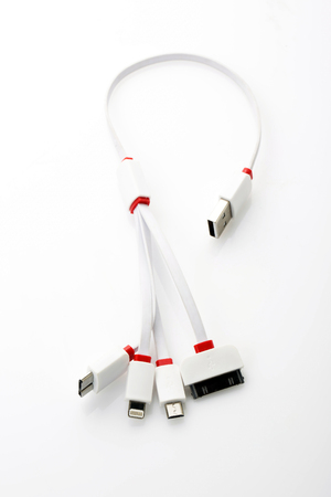charger: Universal mobile charger cord on background