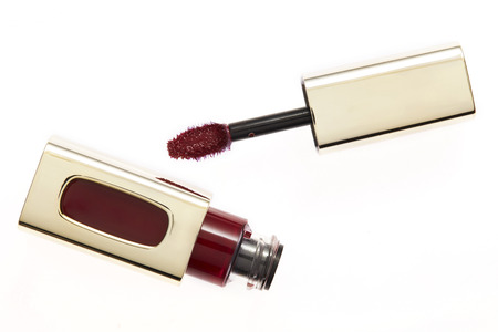 gloss: Red lip gloss brush and container Stock Photo