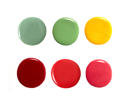 yellow paint: Colourful round shape nail varnish