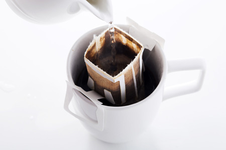 Instant freshly brewed cup of coffee,Drip bag fresh coffee Stock Photo