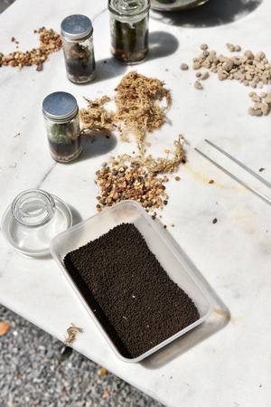 plastic container: Fertilizer in plastic container in plastic container on table