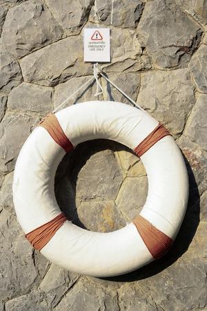lifesaving: Life-saving equipment hanging on wall Stock Photo