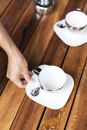 teacups: Hand putting Teacups on table