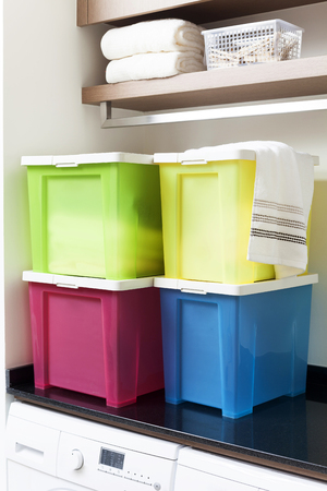 Colorful storage boxes on shelf Фото со стока - 57489817