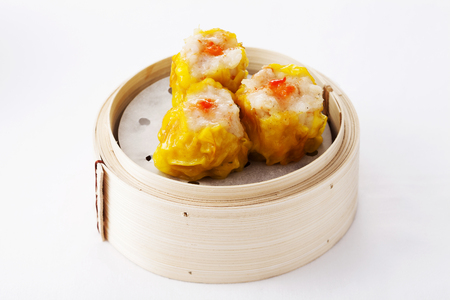 Shrimp dumplings in a bamboo steamer