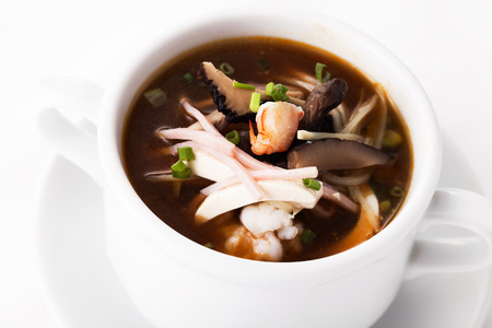 Sichuan soup serve in white bowl