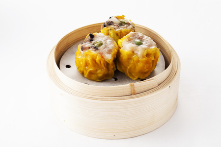 Chinese mushroom dumplings in a bamboo steamer