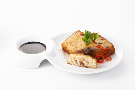 Fried Radish cake on plate with black sauce