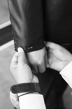 pinning: Hand of man tailor pinning dummy suit for customer Stock Photo
