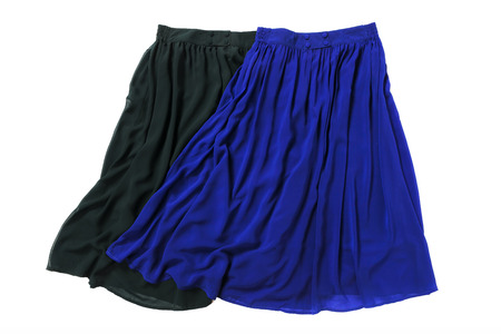 skirts: Blue and green fashion skirts on background Stock Photo