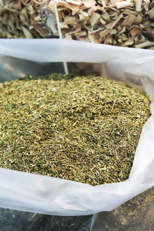 pile of leaves: Pile of dried rosemary leaves in plastic sack for sell