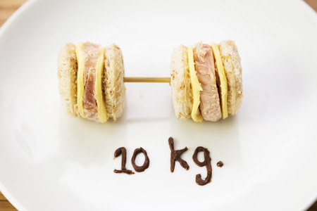 weight control: Weight control concept-mini sandwiches in dumbbell shape