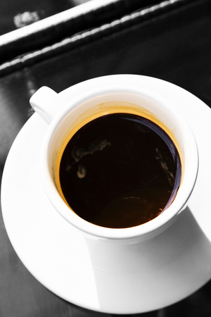 double glass: Double espresso in cup on glass table