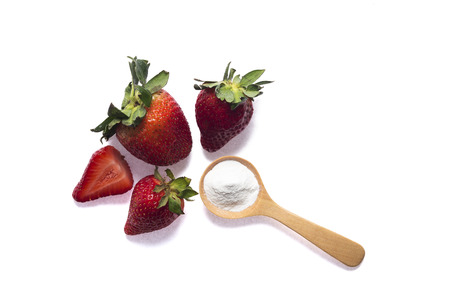 bicarbonate: Strawberries and baking soda in wooden spoon for tooth whitening Stock Photo