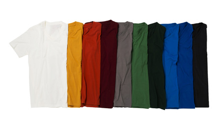 Colorful T-shirts folded group on background