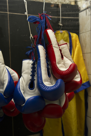 Boxing Gloves Hanging On Storage Room Stock Photo   76951540
