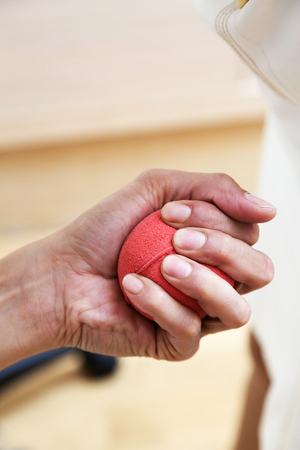 Hand squeezing a rubber ball for blood testing Stockfoto