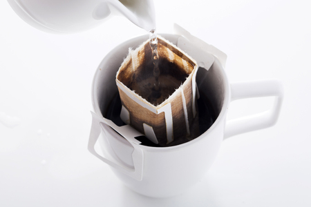 Instant freshly brewed cup of coffee,Drip bag fresh coffee Imagens