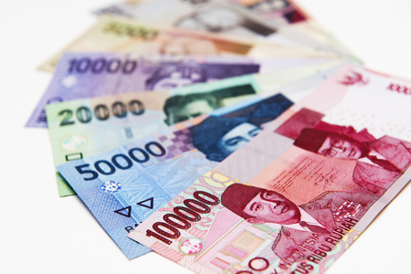 Colorful of Indonesia banknotes stacked on background Stock Photo