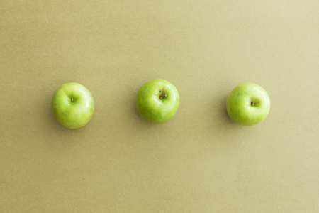 Green fresh apples on paper background Stock Photo