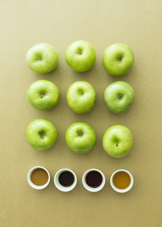 Green fresh apples and ingredient on paper background Stock Photo
