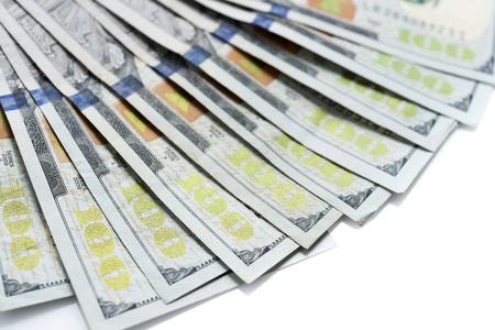 Hundred dollar bills stacked on background