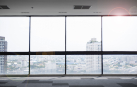 Blur background of building wide window with flare Фото со стока