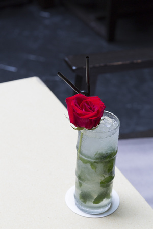 Mojito cocktail with red rose decoration