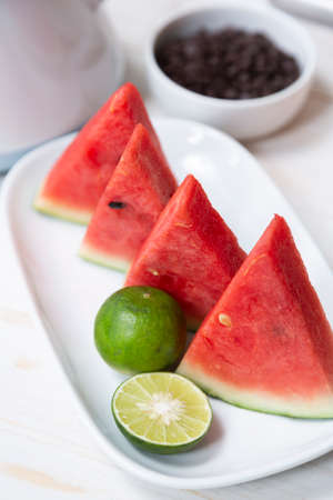 Watermelon cut in pieces on plate for refreshing
