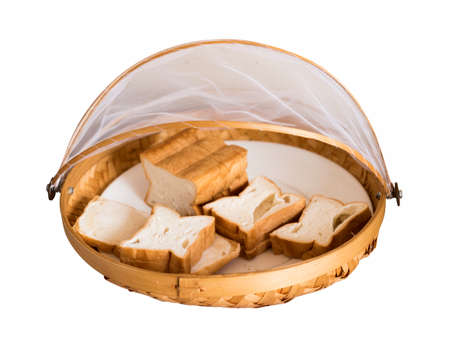 Bread in bamboo weave tray isolated on background