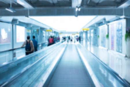Blur background of escalator walkway perspective