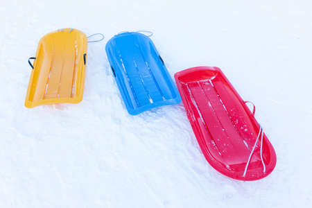Empty colorful snow sledge on lockdown