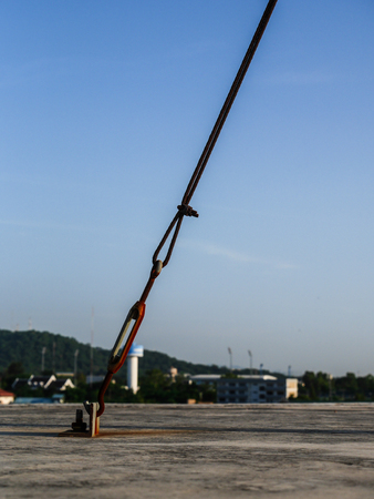 fasten: Rust sling on concrete floor Stock Photo