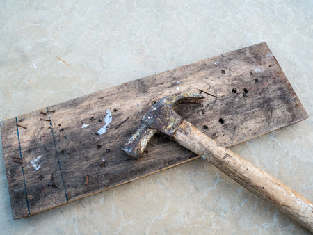 Hammer with wooden boards on the floor