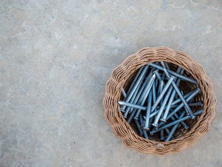 concrete tack with a basket on the floor