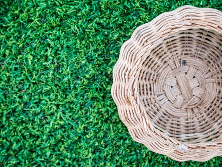 Brown basket on green grass