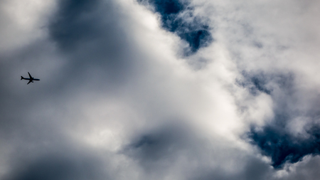 Small plane on the vast sky