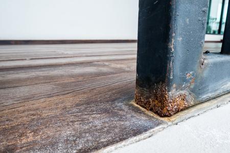 Rust on black iron fence