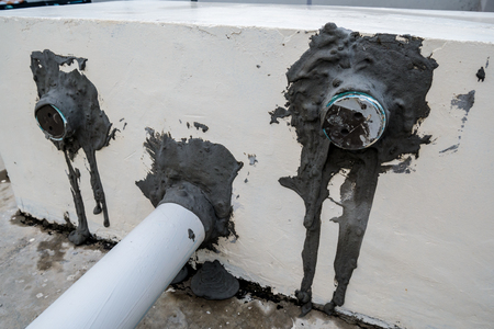 PVC pipe in cement wall