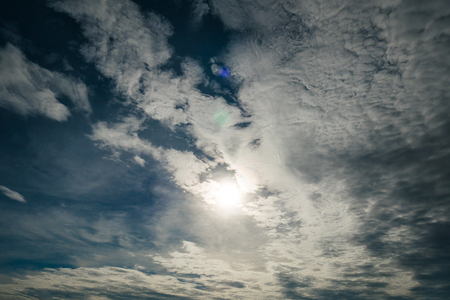 Blue sky with white clouds and sun Stock Photo
