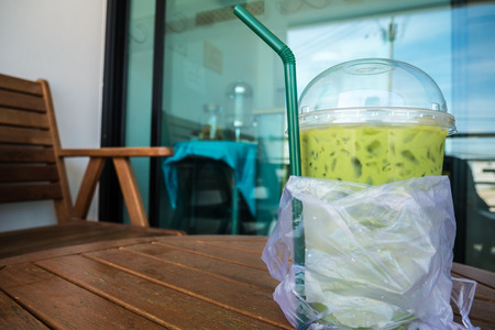 Iced green tea in plastic glass