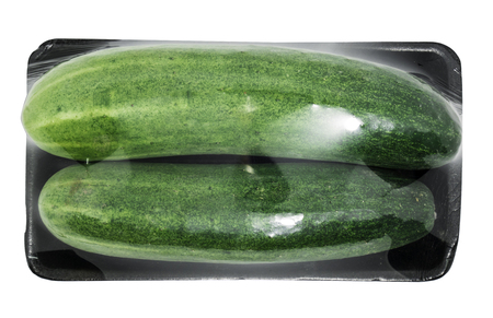 Cucumbers in a package on a white background with clipping path.