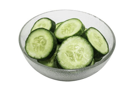 Cucumber in bowl on a white background with clipping path. Stock Photo