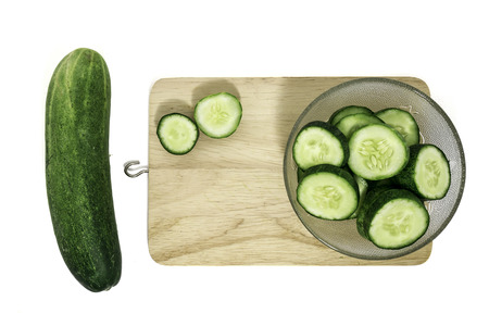 Cucumber on a cutting board on a white background. Stock Photo - 91730807