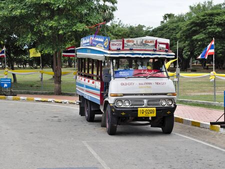 SUKHOTHAI THAILAND-04 AUGUST 2019:Old buses used to transport passengers between the old cities (Sukhothai Historical Park World Heritage) with the new city of Sukhothai.