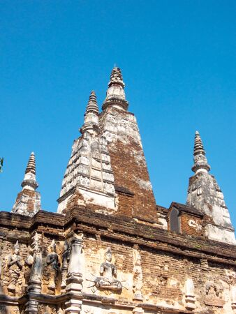 Wat Chet Yot temple, B.E. 1998 King Bhumibol Adulyadej The 9th King of the Mangrai Dynasty built of laterite decorated with stucco designs. Is a Bodh Gaya pagoda India.