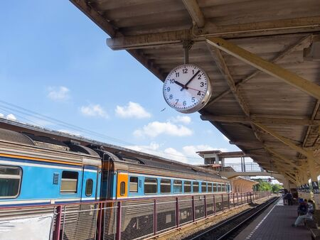 Train station is the main station with a clock in the sky.