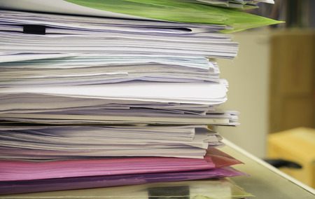 Pile of papers on the desk