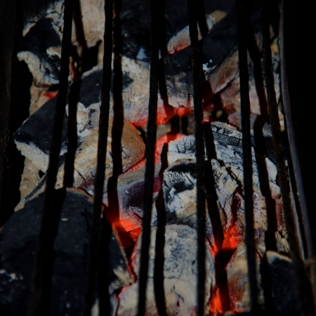 Decaying coals for cooking and a background  Stock Photo